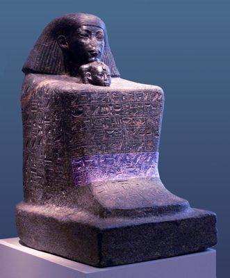 Black granite block statue of Senenmut 