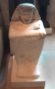 Limestone block statue of the Vizier User-amen in the Louvre